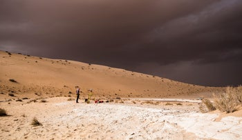 A storm arrives during excavation of the remains of a paleo-lake in northern Saudi Arabia, where ancient humans lived alongside animals such as hippos