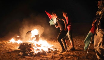 Palestinians protest along the border fence with Israel, east of Khan Yunis in the southern Gaza Strip, on Monday.