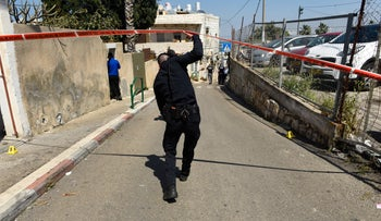A policeman at the scene of a shooting in Haifa, in March.