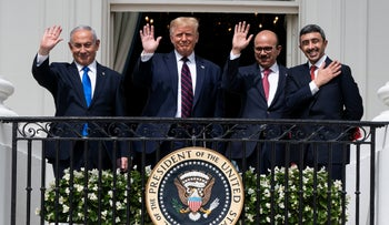Israel's Benjamin Netanyahu, former U.S. President Donald Trump, and Bahraini and UAE foreign ministers pose for a photo after signing the Abraham Accords at the White House in Washington, last year.