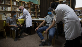 Students getting COVID shots in Ramallah on Sunday