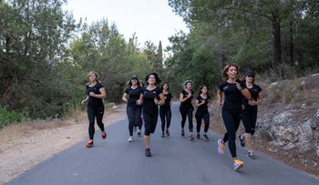 Members of a running group in northern Israel. 'Physical activity is recommended not only for its health benefits.'