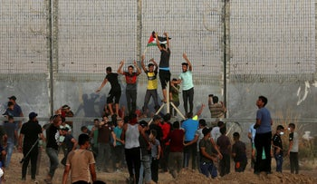 Protesters on the Palestinian side of the Gaza border on the day when Shmueli was shot, earlier this month.