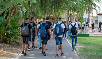 Students in Afula on their way to school as new school year starts, today.