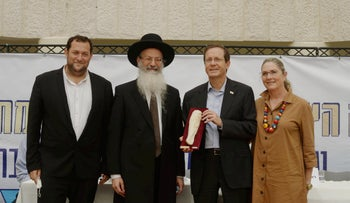 Israeli President Isaac Herzog in the West Bank with his wife and settler leaders, on Tuesday