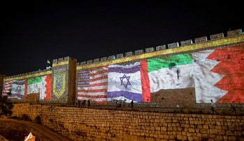 Flags of Israel, Bahrain, the UAE and the United States projected on the wall of the old city in Jerusalem