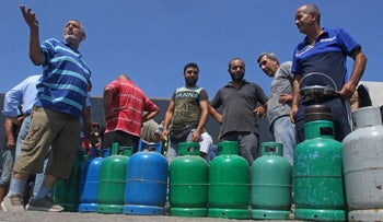 Lebanese wait to fill their gas cylinders in the southern city of Sidon amid a deepening economic crisis, last month.