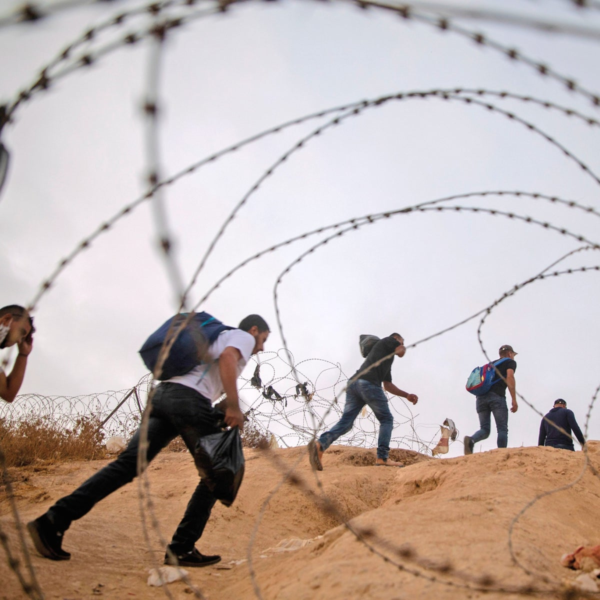 Palestinian workers cross illegally into Israel from the West Bank, in a 2020 photo. Every mention of Palestinian suffering is seen as harmful to the state.