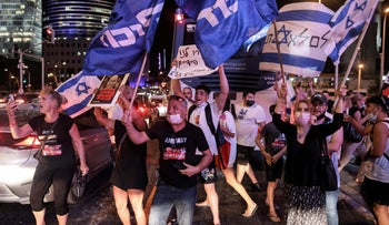 People chant slogans and wave flags of Israel and the Likud party during an anti-government demonstration following the death of Barel Hadaria Shmueli, in Tel Aviv, last week.
