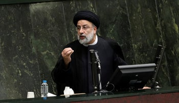 Iranian President Ebrahim Raisi defends his proposed ministers in a session of parliament, in Tehran, Iran, last month.