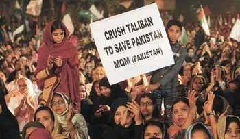 Pakistani protesters expressing solidarity with families of the students killed in a Taliban attack on a military-run school in Peshawar, in 2014.