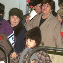 Jewish immigrants from the former Soviet Union wait in line to receive Israeli passports at Ben Gurion Airport, in December 1990.