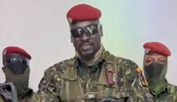 Guinean Colonel Doumbouya delivering a speech after the government was dissolved, in Conakry, Sunday.