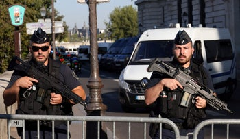 French Gendarmes officers stand guard outside the Palais de Justice of Paris, ahead of the start of the trial of the November 2015 Paris attacks held in a special courtroom, on Wednesday.