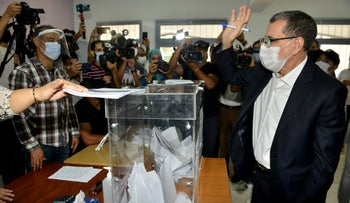 Moroccan Saad-Eddine El Othmani, Morocco's Prime Minister and president of the Islamist Justice and Development Party (PJD) casts his ballot on Wednesday