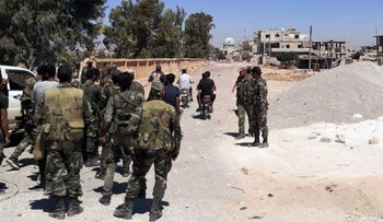 Syrian army forces setting up a checkpoint in Daraa al-Balad, on Wednesday.