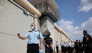 Police officers and prison guards inspect the scene of a prison escape outside the Gilboa prison in northern Israel, on Monday.