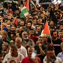 Demonstrators take part in a rally in support of Palestinian prisoners held in Israeli jails, in Ramallah, the West Bank, on Wednesday.