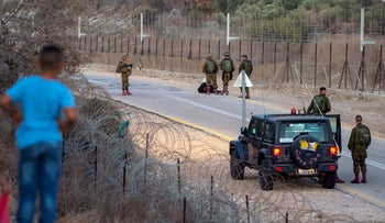 Israeli soldiers search for the escaped prisoners near the West Bank fence, on Thursday.