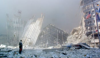 A man stands in the rubble after the attack on the World Trade Center Tower in lower Manhattan, New York, in 2001.