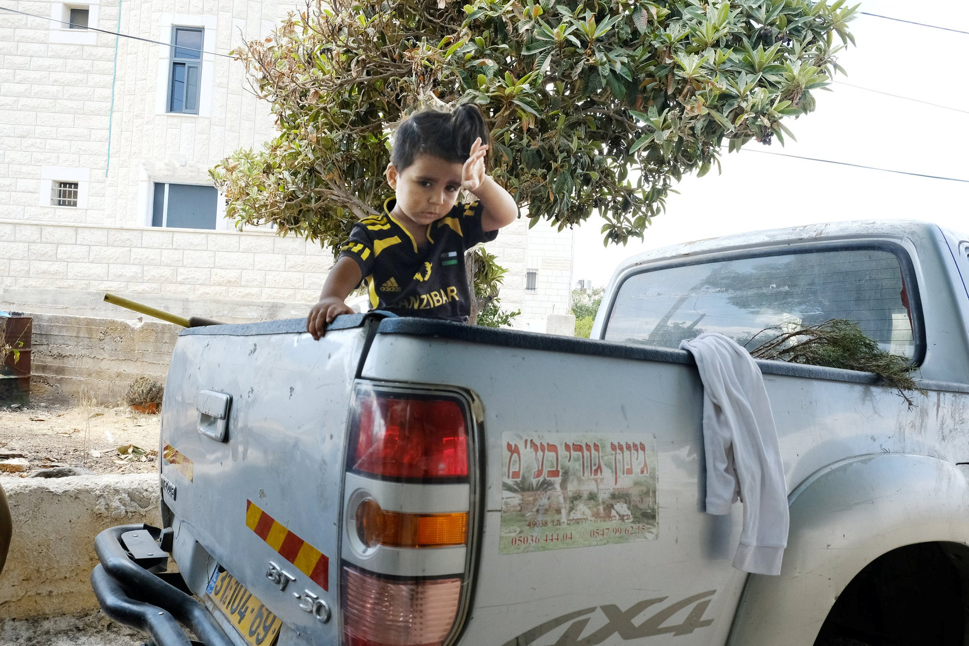 Raed Jidallah's 3-year-old son Mohammed, in his father's truck.