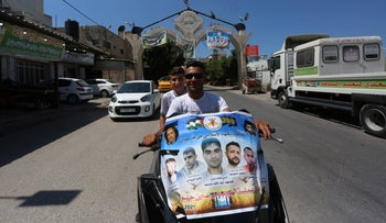 A motorcyle in the Jenin refugee camp decorated with a poster in support of the Jenin-area residents who broke out of an Israeli prison on Monday.