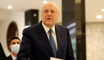 Lebanon's Prime Minister-Designate Najib Mikati arrives to meet with President Michel Aoun at the presidential palace in Baabda, on Friday.