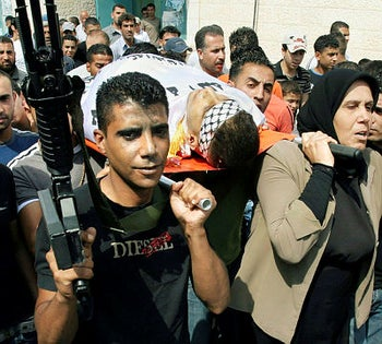 Zakaria Zubeidi helps carry the body of a commander of the Al-Aqsa Martyrs' Brigades in the Jenin refugee camp in 2007.