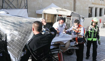Palestinian suspected of attempted stabbing being taken to the hospital, Jerusalem's Old City, today.