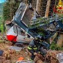 Rescuers work by the wreckage of a cable car after it collapsed near the summit of the Stresa-Mottarone line in northern Italy, in May.