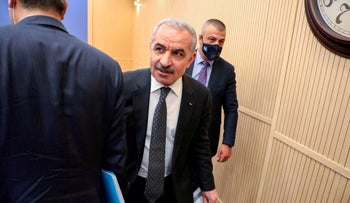 Palestinian Prime Minister Mohammad Shtayyeh arrives to hold a press conference in Ramallah in 2020.