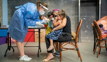 Children are tested for the coronavirus at a testing center in Jerusalem, last month.