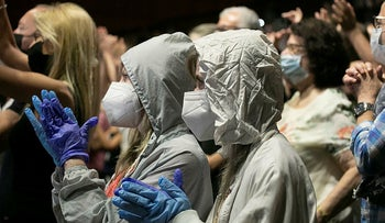 Concert goers wear masks and gloves while attending a show in Tel Aviv