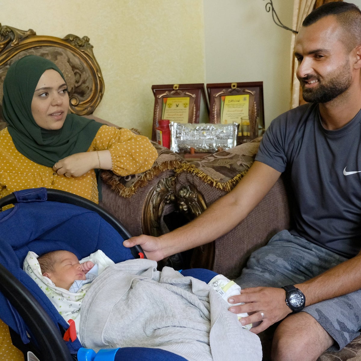Anhar al-Dik, her husband Thaar al-Haj'a and their son Ala, this week. He spent most of his time in the womb of a mother in jail, but was born into a relative sort of freedom.