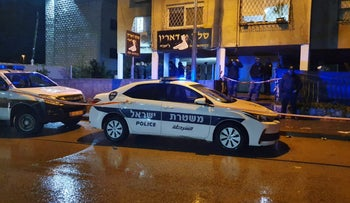 A police car at the scene of a shooting in Ramle, last year.