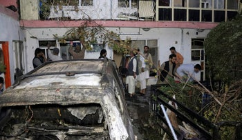Afghans inspect damage of Ahmadi family house after U.S. drone strike in Kabul, Afghanistan, last month.