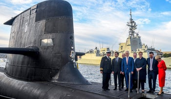 French President Emmanuel Macron and Australian officials celebrating the deal for France to provide Australia with 12 submarines, in 2018.