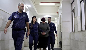 Malka Leifer is brought to a courtroom in Jerusalem, in 2018.