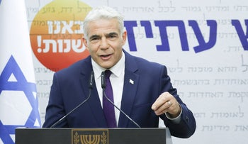 Foreign Minister Yair Lapid speaks at a Yesh Atid party meeting in the Knesset in Jerusalem, earlier this month.