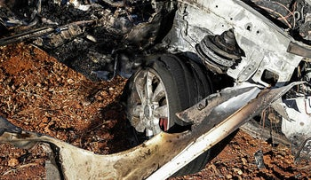A vehicle destroyed by what is believed to be a drone strike, on the northeastern outskirts of Syria's rebel-held northwestern city of Idlib, today.