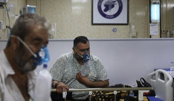 COVID patients breathe with respirators, in the intensive care unit at the Syrian American Medical Society Hospital, Idlib.