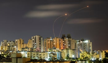 Streaks of light are seen as Israel's Iron Dome anti-missile system intercepts rockets launched from the Gaza Strip towards Israel, as seen from Ashkelon, in May.