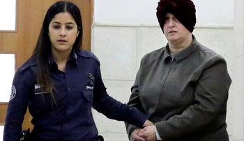 Australian Malka Leifer, right, is brought to a courtroom in Jerusalem, in 2018.