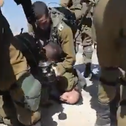 Israeli officer pushes his knee against the head of activist Tuly Flint in the South Hebron Hills on Saturday