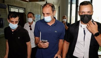 Shmuel Peleg (C), the grandfather of Eitan Biran who was the sole survivor of a deadly cable car crash in Italy, as he leaves the Justice Court in Tel Aviv, today.