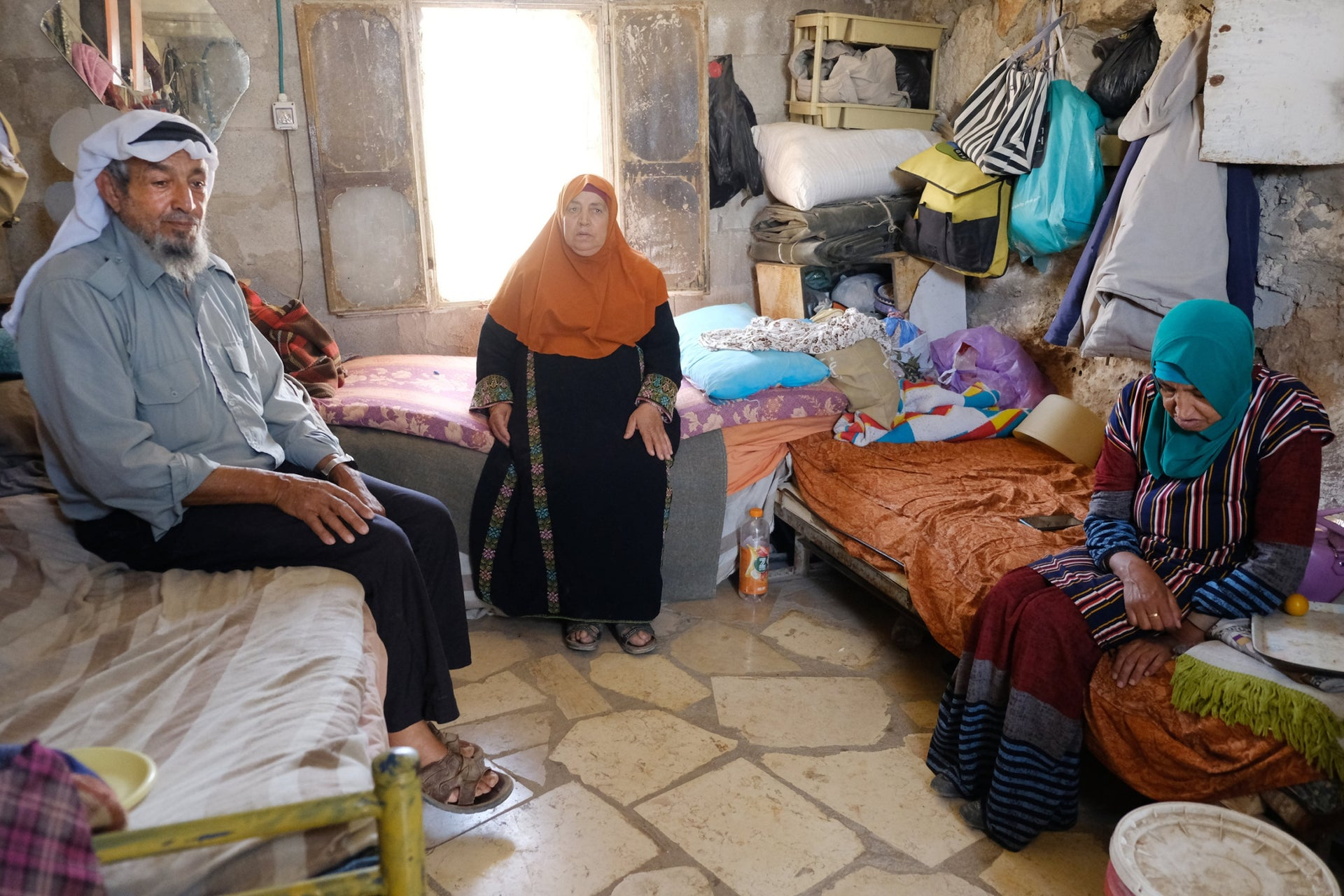 Umm al-Shukkhan is home to three: Ahmad Hamamdi, a farmer with a hearing aid; Halimi, his wife, 67; and her mentally disabled sister, Zarifi, 52.