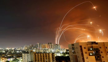 The Iron Dome anti-missile system intercepts rockets from Gaza as seen from Ashkelon, in May.