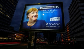 """A poster of Angela Merkel reads """"Mother of the nation. Thank you for 16 years of hard work"""" in Berlin."""