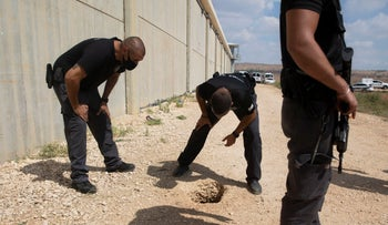 Israeli police examining the exit of the tunnel through which six Palestinians escaped from Gilboa Prison this month.