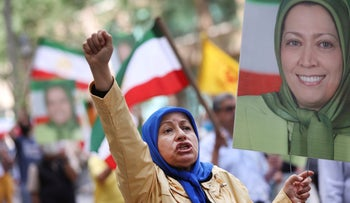 A protester holding a photo of Iranian opposition leader Maryam Rajavi attends a rally to denounce Iranian President Ebrahim Raisi near United Nations headquarters, earlier this week.